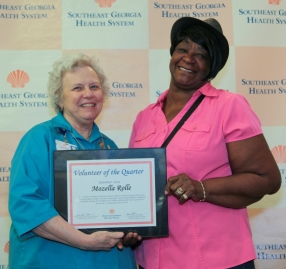 "Mozella ""Mo"" Rolle Receiving Volunteer of the Quarter"